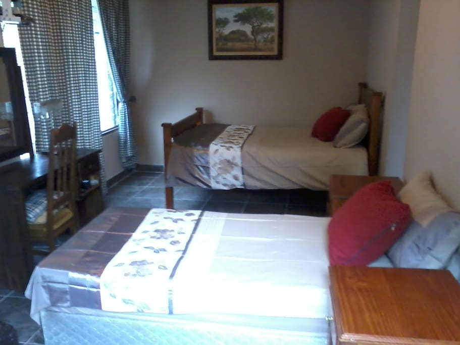 LOVELY COMFORTABLE BEDS,DRESSING TABLE AND CHAIR,CABLE T.V (D.S.T.V )