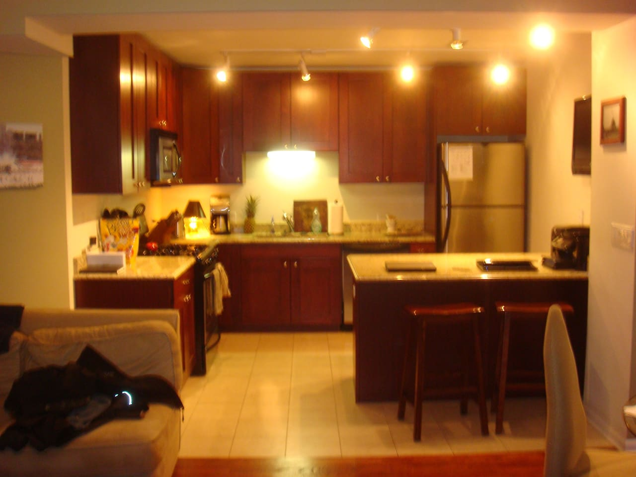 Premium furnishings throughout including granite counter tops, stainless steel appliances, cherry cabinets.  The kitchen is open to the living room, a great spot for entertaining.