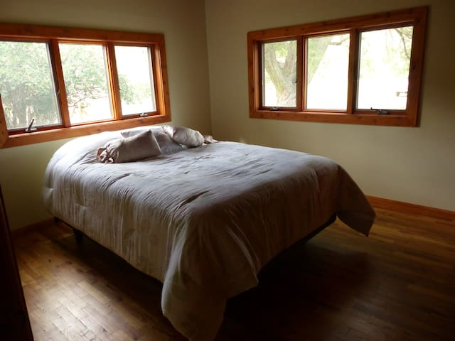 Master bedroom with one Queen