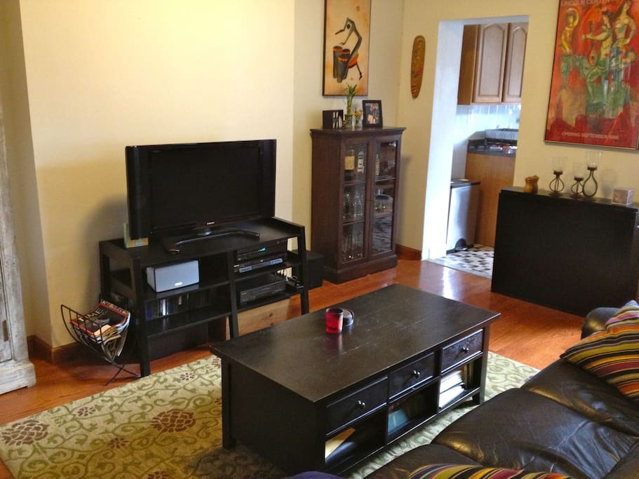 Flat screen TV with cable, HBO, DVR and DVD.