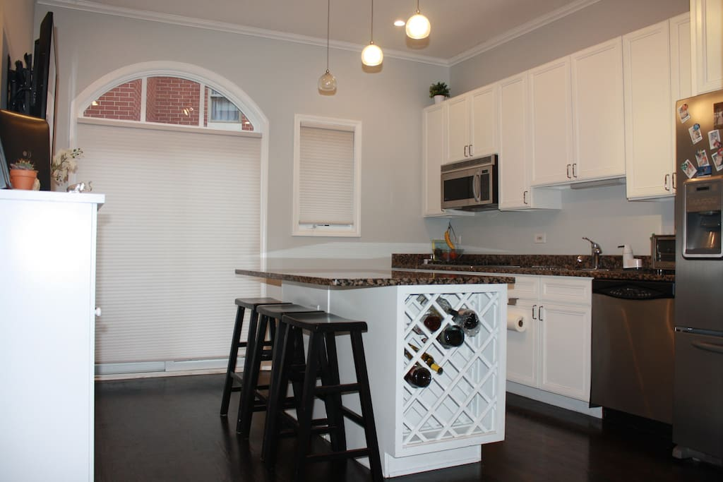 FULLY EQUIPED KITCHEN WITH GRILL IN PATIO.