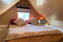Bedroom with queen bed, baseboard heating & lighting controls with dimmer(adjust lighting from the bed)