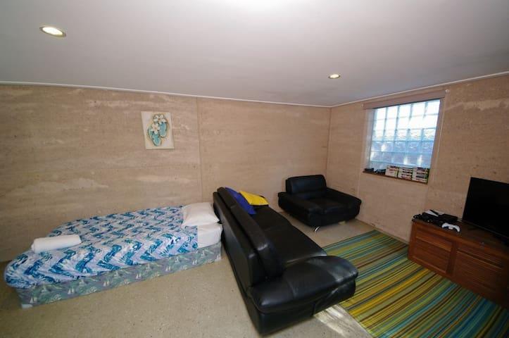 King single bed in downstairs rumpus/bedroom.