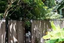 Private entrance reclaimed wood gate leading to Garden Suite