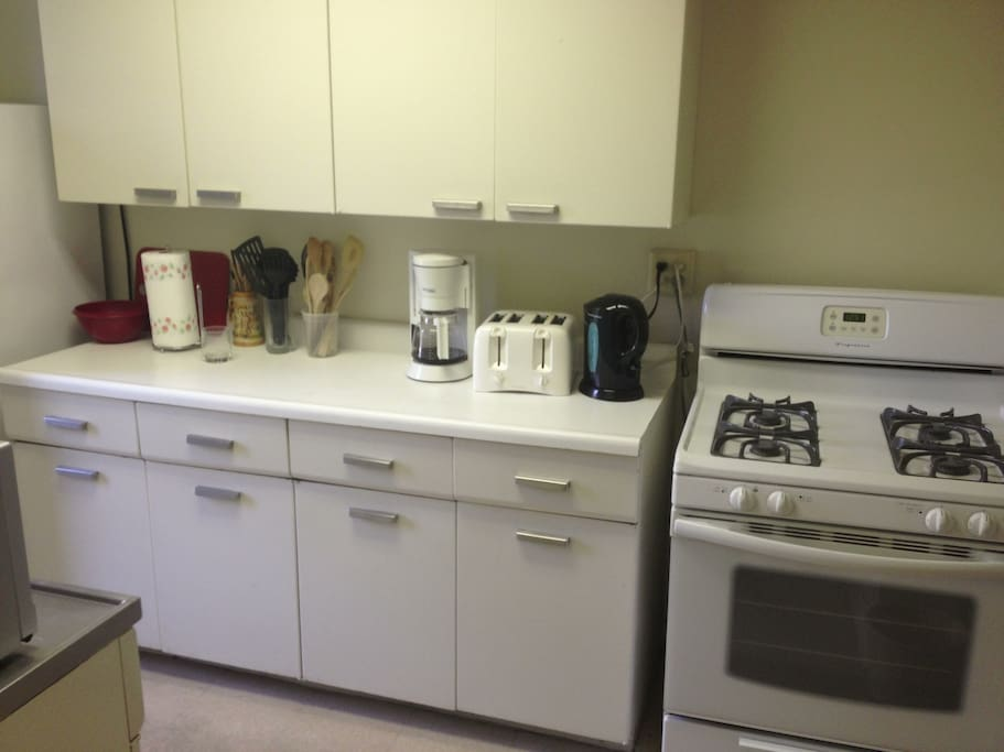 Kitchen has gas stove, large refrigerator, large microwave, toaster, coffeemaker, plenty of cabinets and shelf space, and full sets of pots, pans, dishware, glassware, silverware...