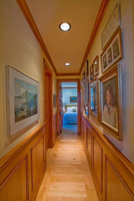 Hallway to two downstairs bedrooms with ensuite baths