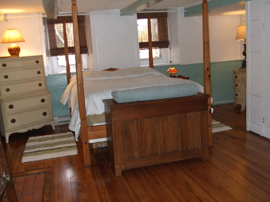 Queen size four post bed, large closet space and dresser drawers for storage