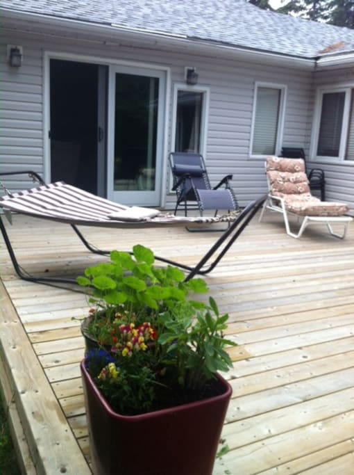 Relax on the new wood deck with view of the lake