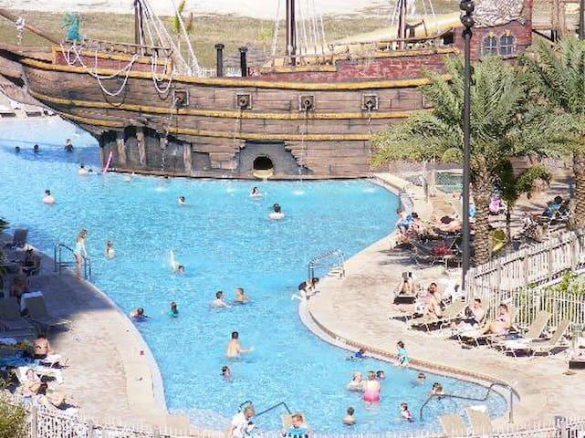 Luxury Condo,With Pirate Ship pool Disney Neighbor