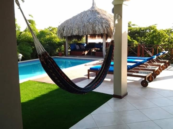Hibiscus Beach House , Double room with pool view.
