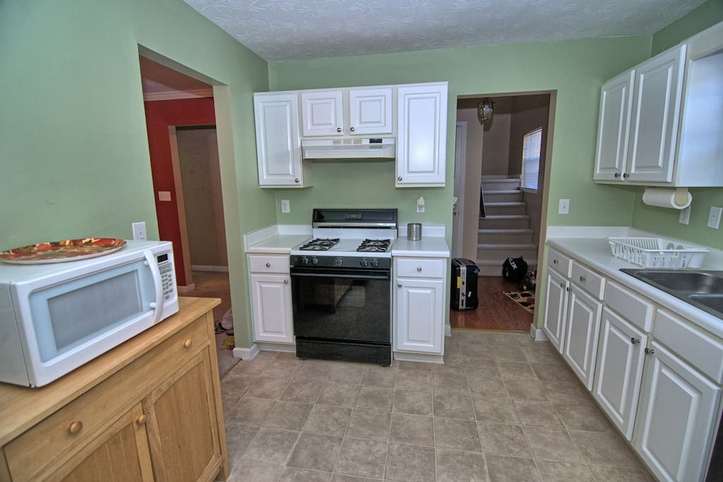 Full kitchen with gas stove, oven and microwave