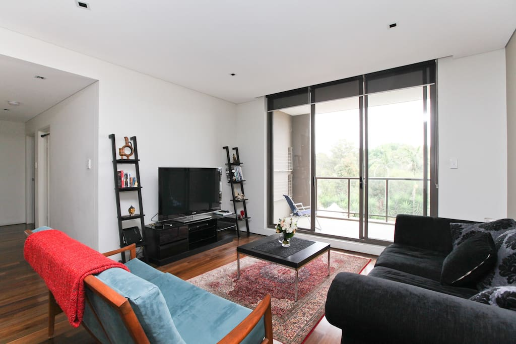 The living area opens out to the balcony
