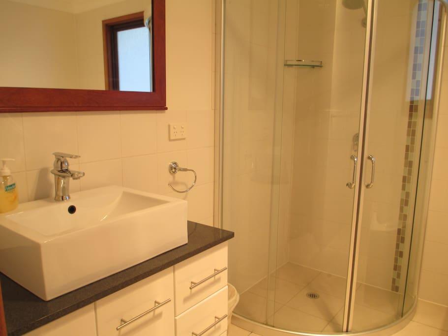 Main bathroom which has a bath
