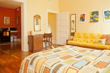 The unit consists of two large rooms: the bedroom with futon couch and the kitchen.