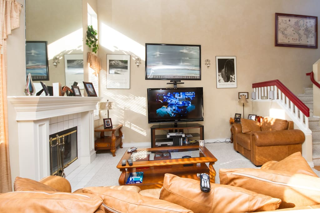 living room with 55 inch flat TV and fire place