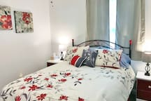 The Red Floral bedroom on the first floor has modern touches and a lovely ceiling fan for your comfort!
