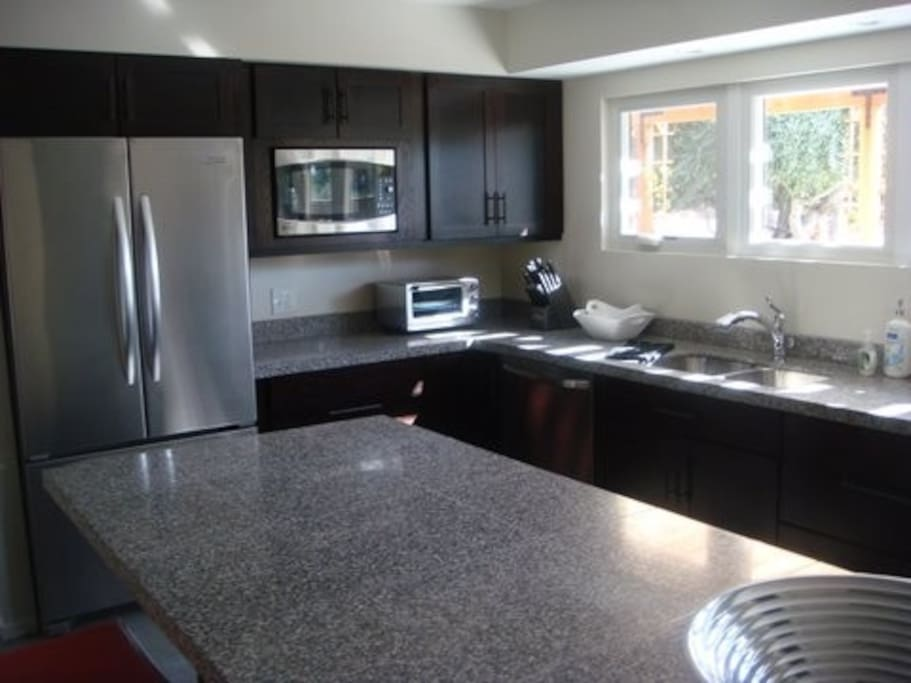 Fully stocked kitchen for entertaining or enjoying a meal poolside
