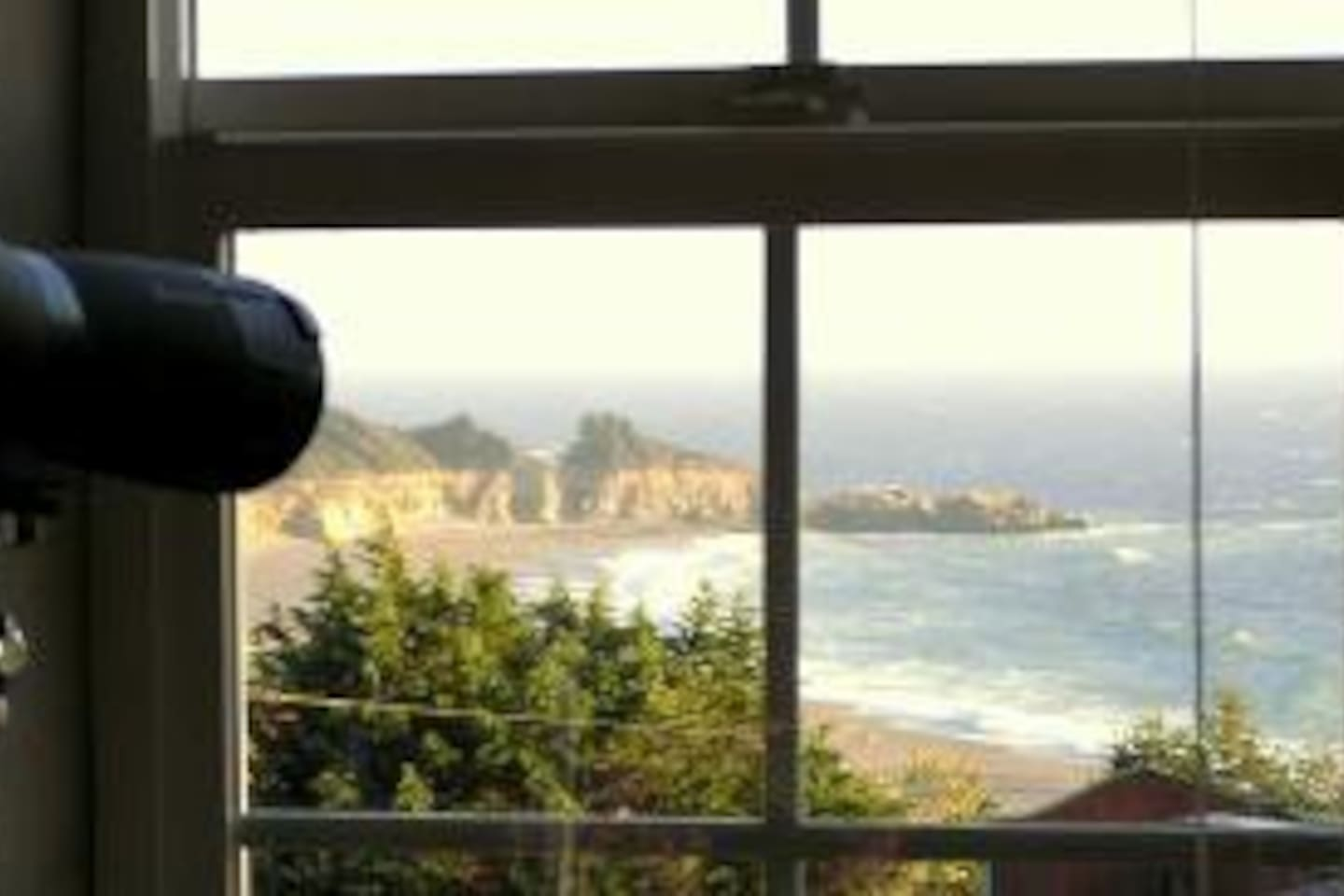 The view of the beach, surf and ocean from most  windows at SeaWatch.  Passing whales have been sighted from here.