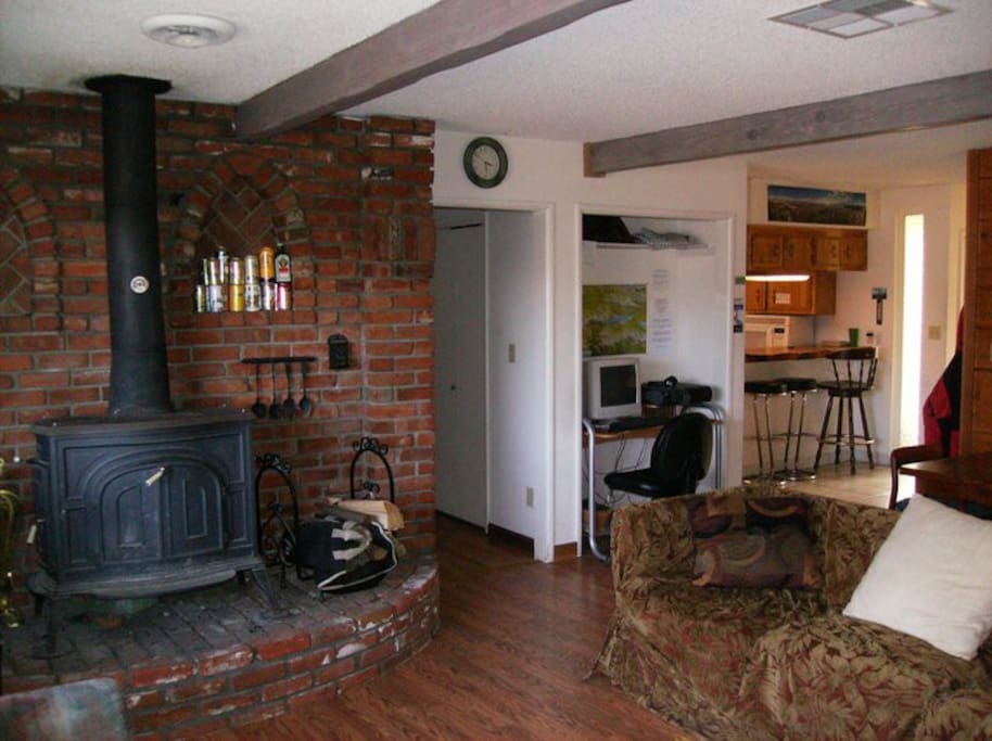 Wood stove in living room. All rooms also have central heating. This is a shared house.