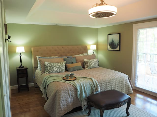 The Master bedroom has 2 full sized closets, TV, king sized bed, and a balcony that overlooks the river.  Rest, Relax, and Repeat.