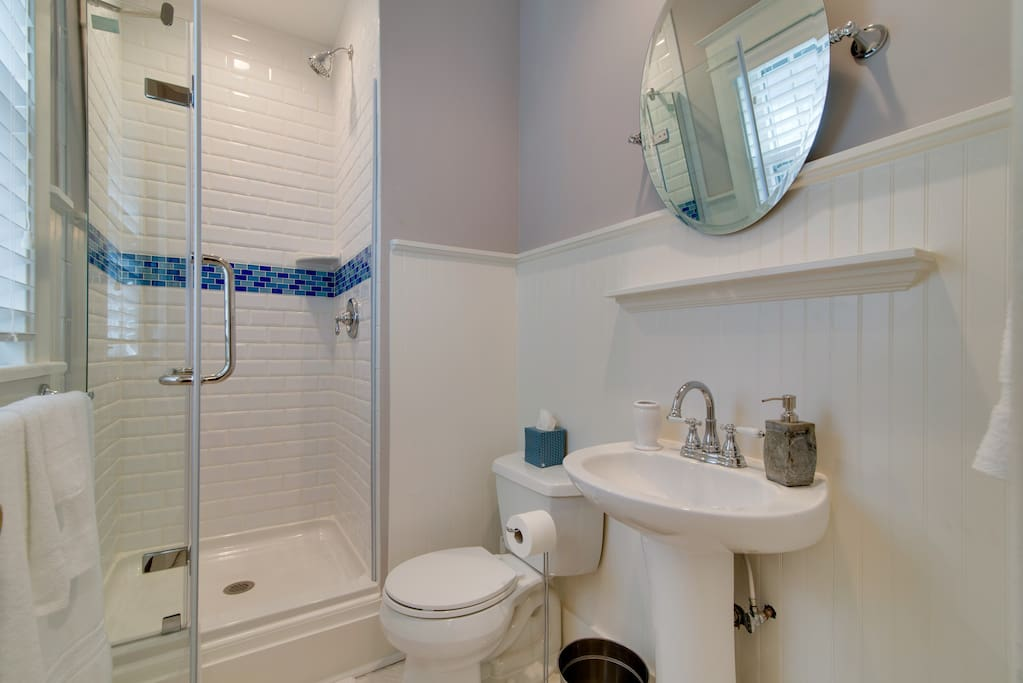 Refresh in the bathroom's step-up standing shower.