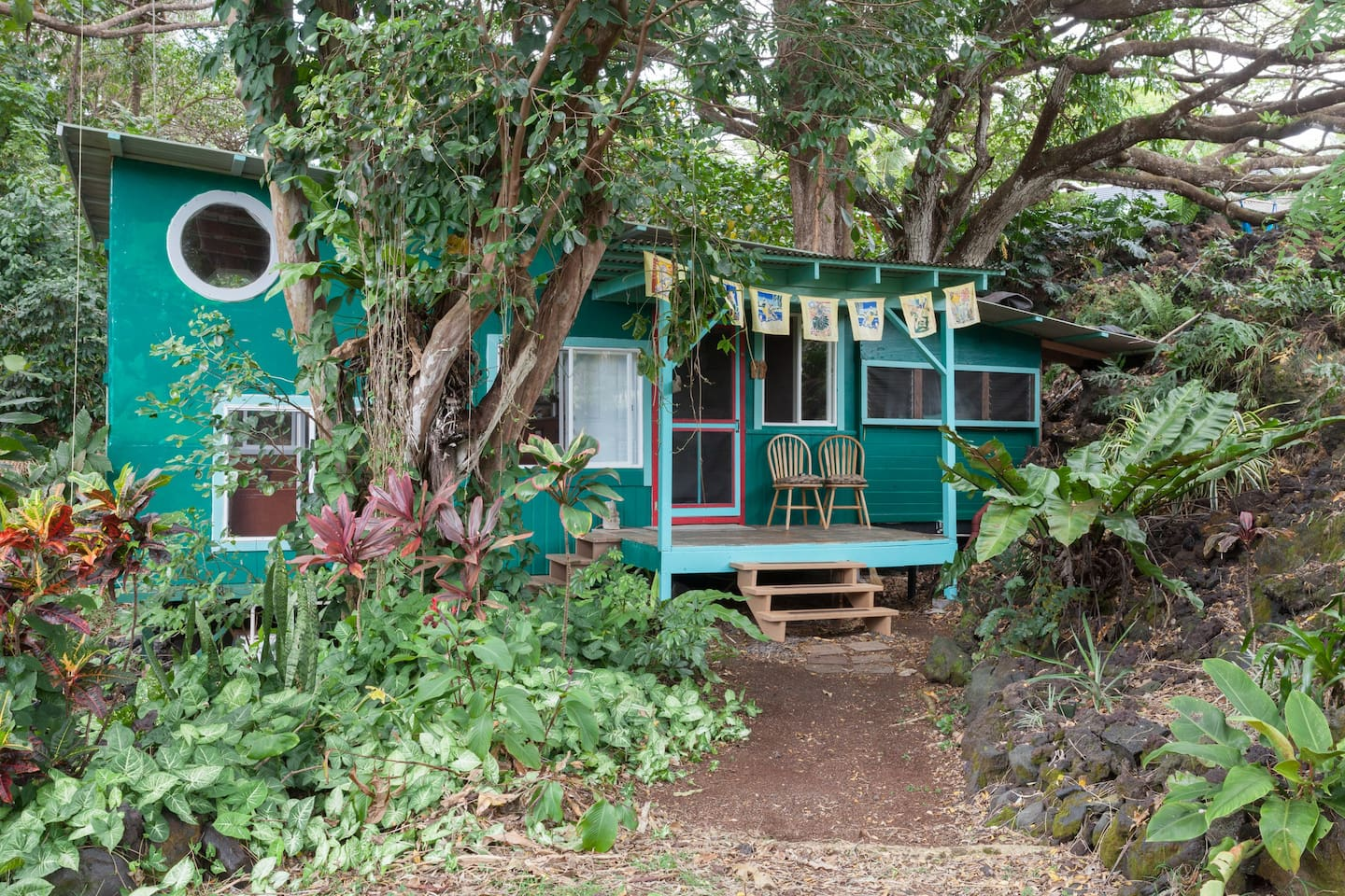 The Magical Grotto Cottage was begun in 1991 and hidden away under ancient and giant trees that create a thirty foot canopy. There is some history as the exterior wood was once the flooring of a stage that the owner built in Madison Wisconsin.