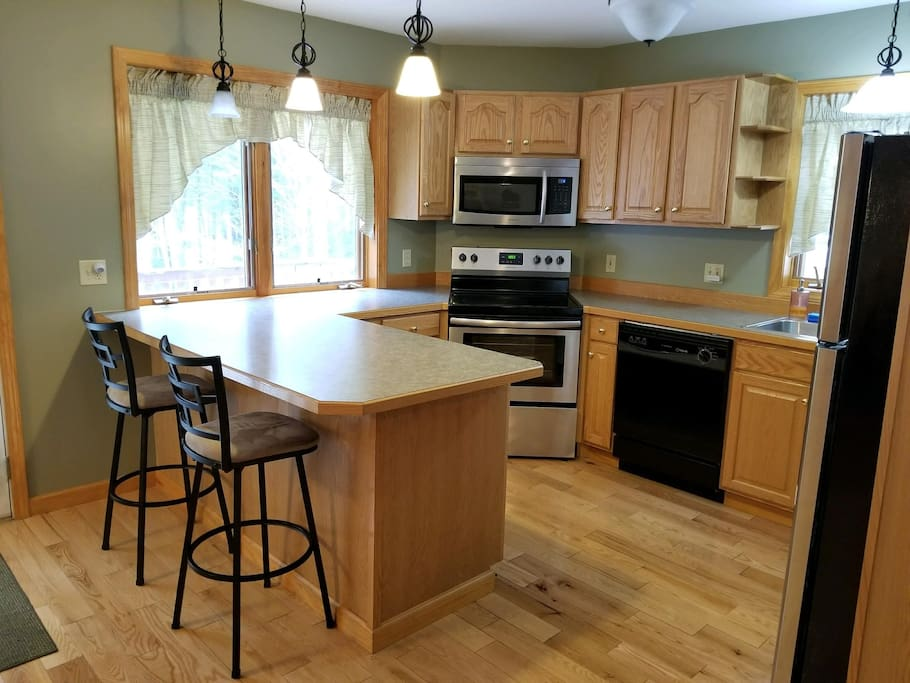 Kitchen with dishwasher, fridge, oven, microwave, coffee maker, blender and toaster. All dishes, pots, pans, utensils included.