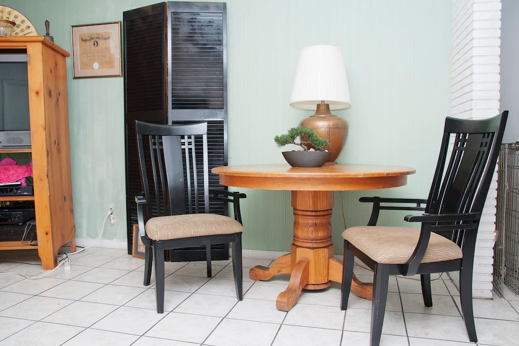Table and chairs in living room.