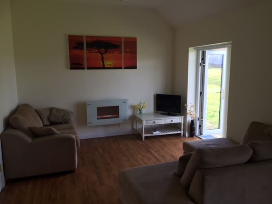 Comfy, warm sitting area, french doors to lawn & lake