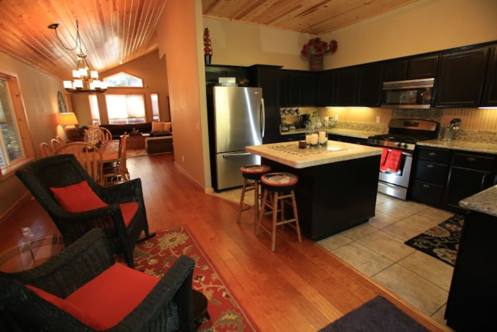 The well equipped Kitchen with granite countertops, stainless appliances.