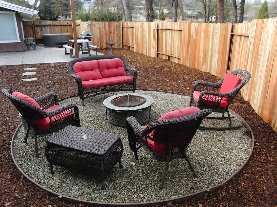 New fire pit seating area in fully fenced yard.