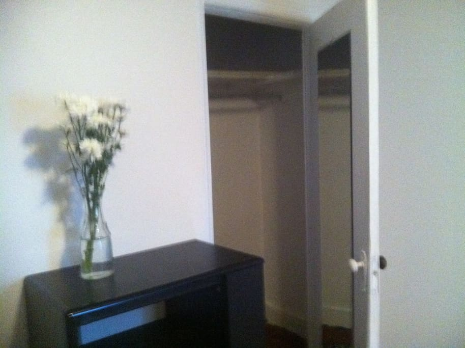 View into the large closet of your bedroom.  Big shelf, tons of space for storage.