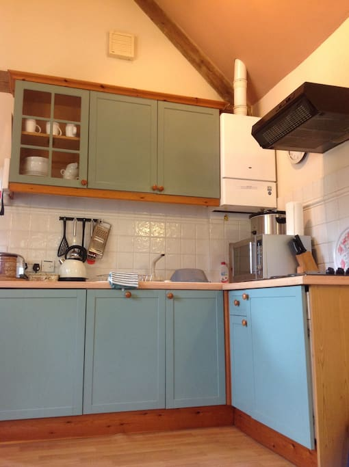 A well appointed kitchen for cooking your tea with a dishwasher for doing the washing up!