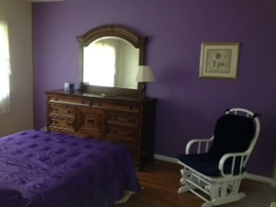 The Purple room is  elegant with double closets.
