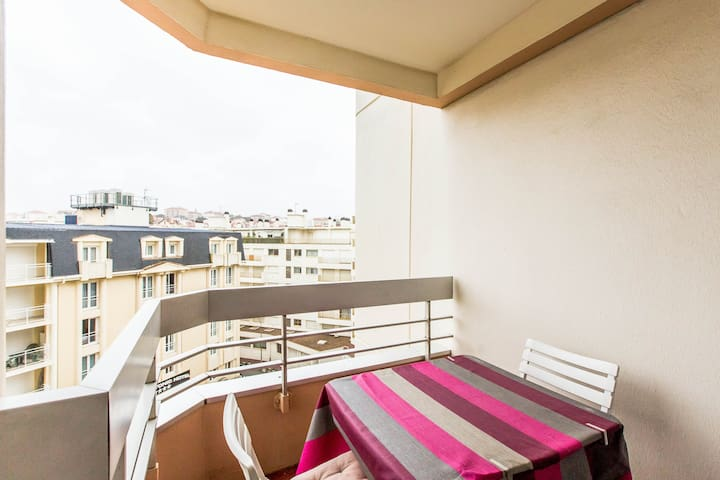 Covered balcony oriented South/East with view of the rooftops of Biarritz