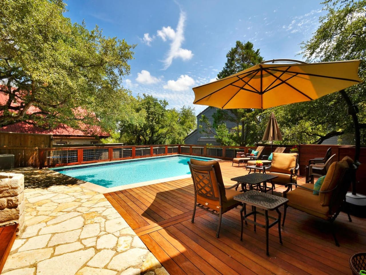 Large outdoor patio with outdoor dining, lounging and grill.
