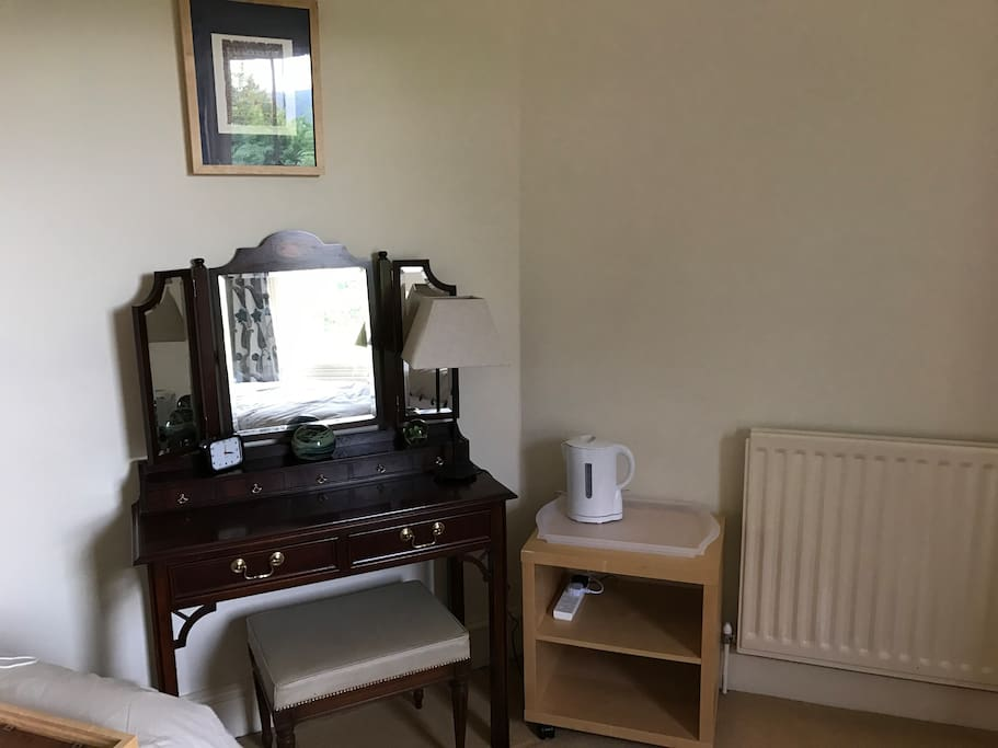 Dressing table and refreshments in room.
