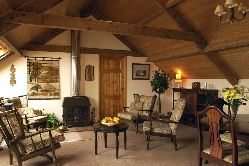 Living room The Old Barn with its original beams (1868)