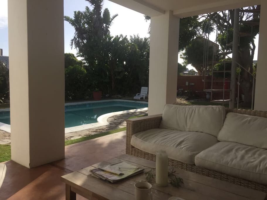 Garden with swimming pool and barbecue facilities to relax and unwind.