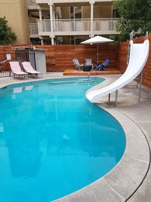 relax at pool with working waterslide off of patio