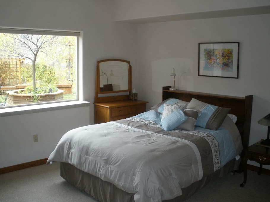Spacious main bedroom with a view.