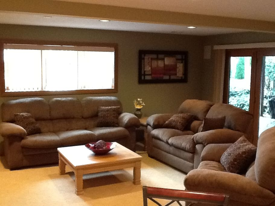 Main living area is daylight with private entrance to the right that leads to a patio & the pond.