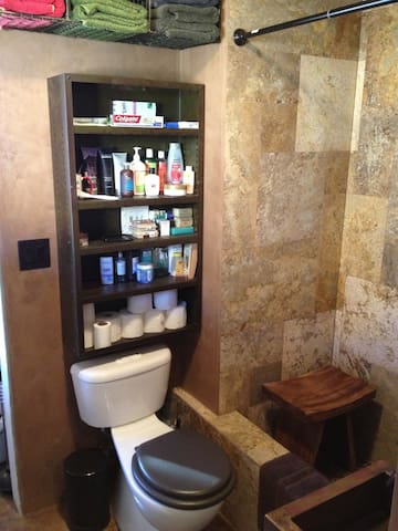 Bathroom - Travertine stone tub/shower. Copper sink.  Dual flush toilet. Stocked for your use.