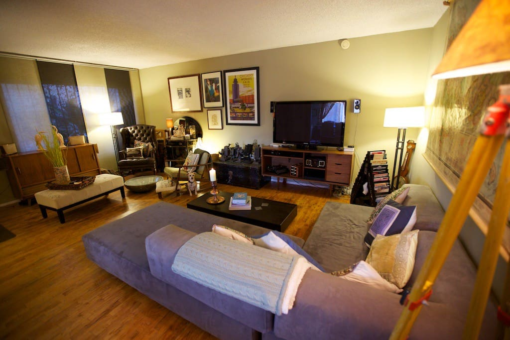 Our roomy and arty living room has couches and comfort for days but the sophistication of antique furniture and rich dark leather.