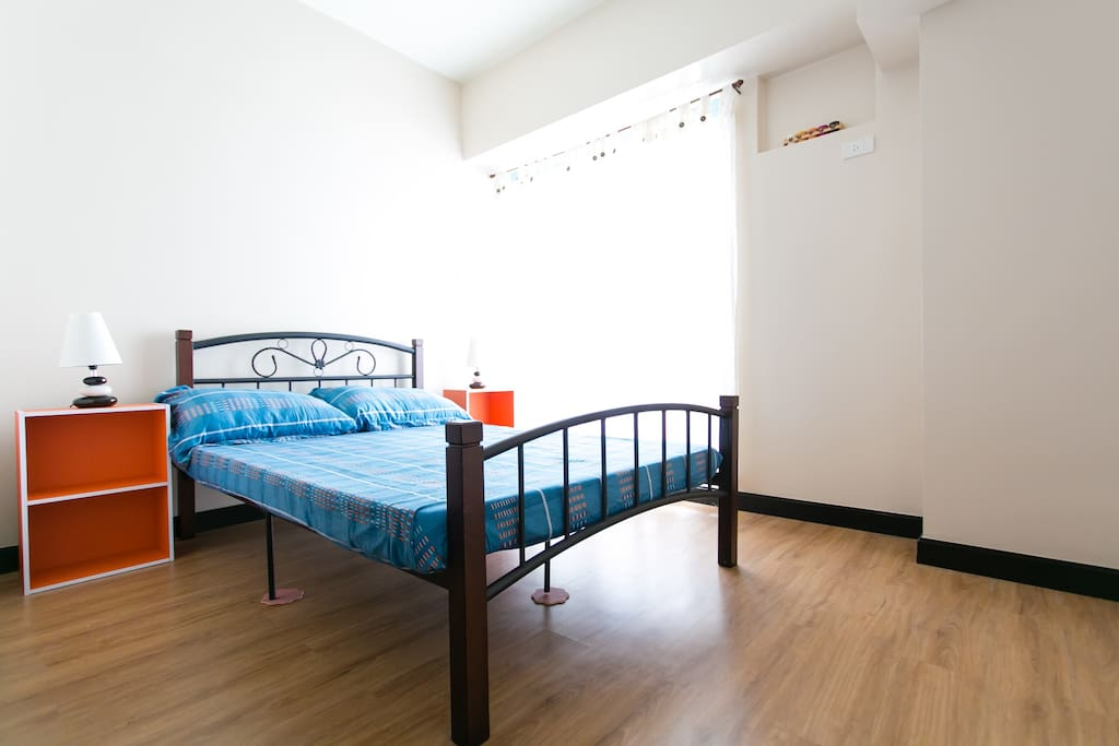 A comfortable double bed with freshly laundered beddings. WITH ITS OWN AIR CONDITIONING UNIT. The bedroom has its own balcony with a magnificent view of the city and river. It's a separate room from the living room.