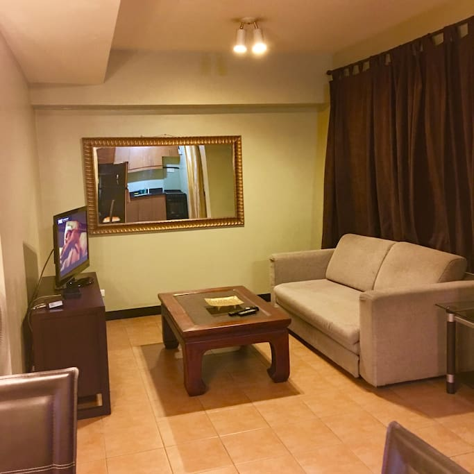 """Living room with 36"""" flat screen TV and cable channels and Internet"""