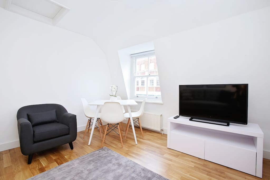 The living room has a flat screen TV and there is free Wi-Fi available throughout the flat