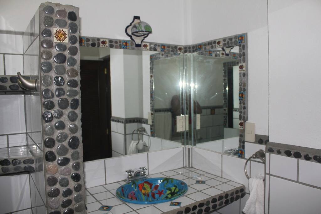 Bathroom with shower, hot and cold water
