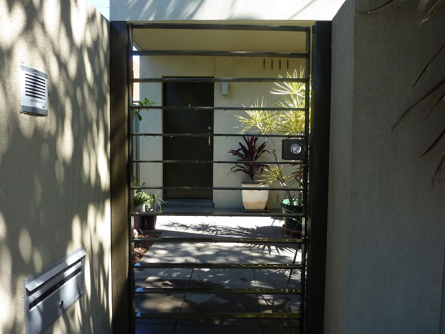 Own entrance lockable gate and entrance door.