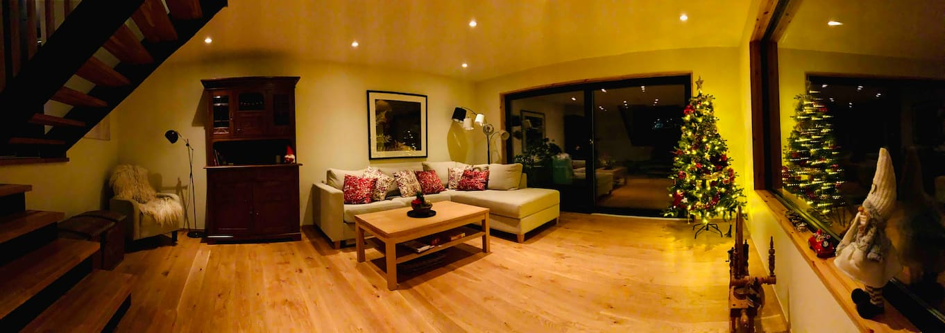 The living room is spacious with panorama windows to the forest and a comfortable sofa which also is a pull-out sleeping sofa. Bed clothes are inside the sleeping sofa, and extra ones are in the antique chest in the living room.